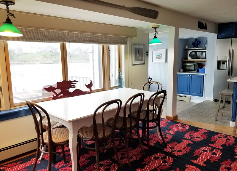Dining room is between the kitchen and living room. It has a lovely water view!