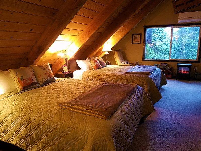 Les deux lits queen dans le loft