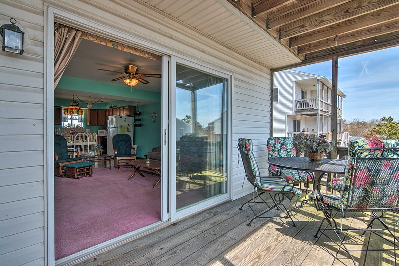 The screened in deck is the perfect place to dine al fresco!