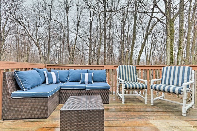 Enjoy leisurely evenings on the spacious deck, equipped with outdoor furniture.