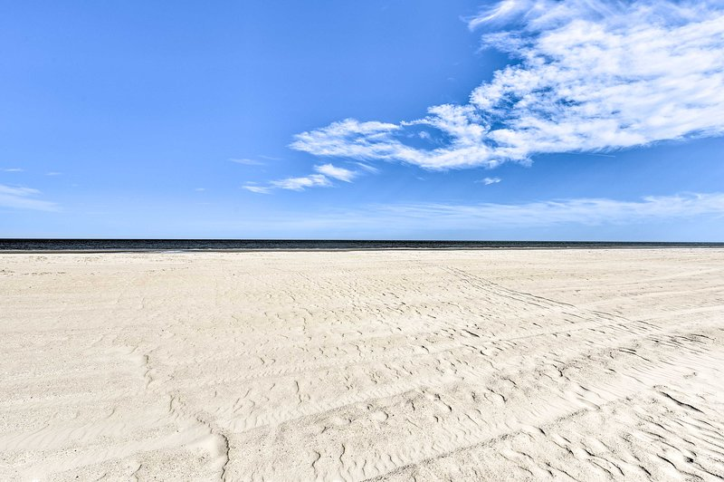 The white-sand shoreline is just 200 feet away from your front door!