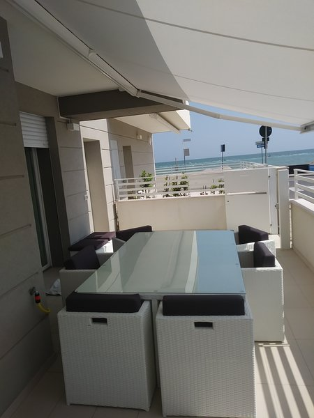 Sea view terrace with furniture