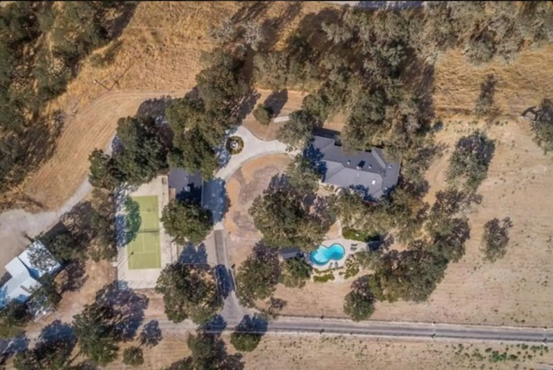 30 acres of oaks and views, with pools and tennis court.
