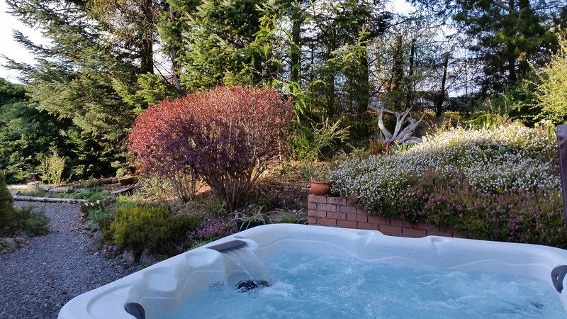 6 person hot tub, just installed. Relax and enjoy the heathers and silver trees in the garden