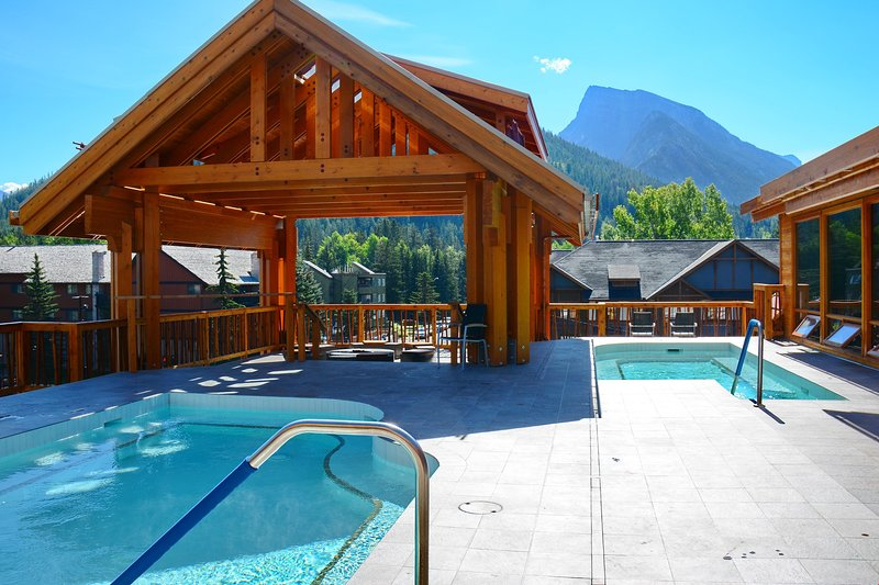 Check out these amazing rooftop hot pools, with views of the mountains!