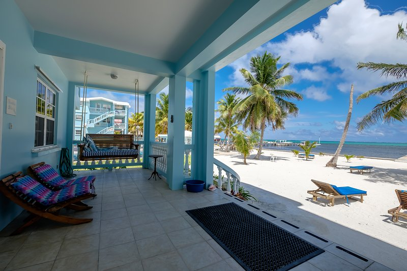 View of the beach and turquoise Caribbean beyond from your front porch!