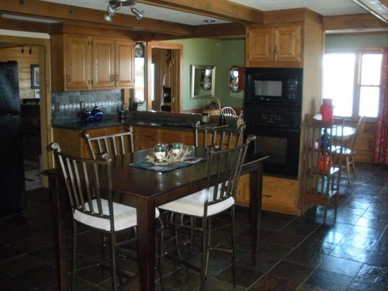 Modern Kitchen, with dining room table overlooking the lake