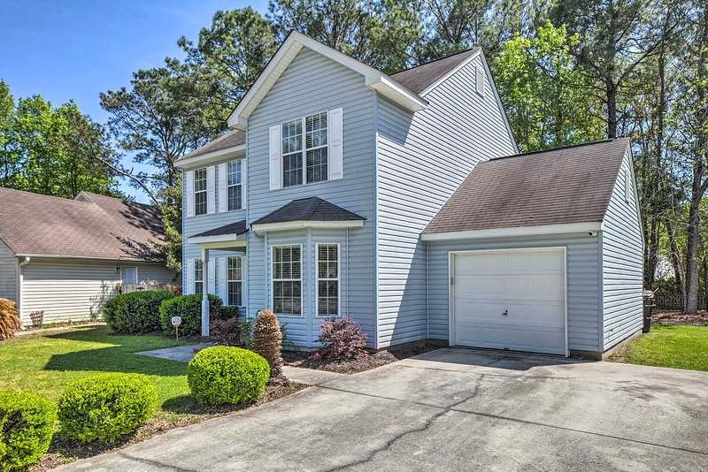 Explore charming South Carolina from this private home with a fishing pond!