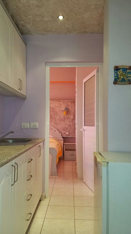 Hallway with small kitchen and small fridge, entry 1