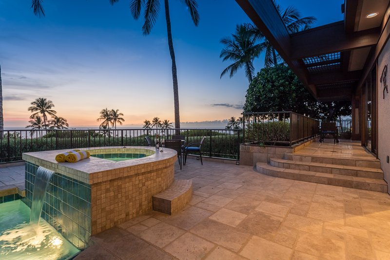 View of waterfall jacuzzi at sunset, looking toward upper lanai and ocean.