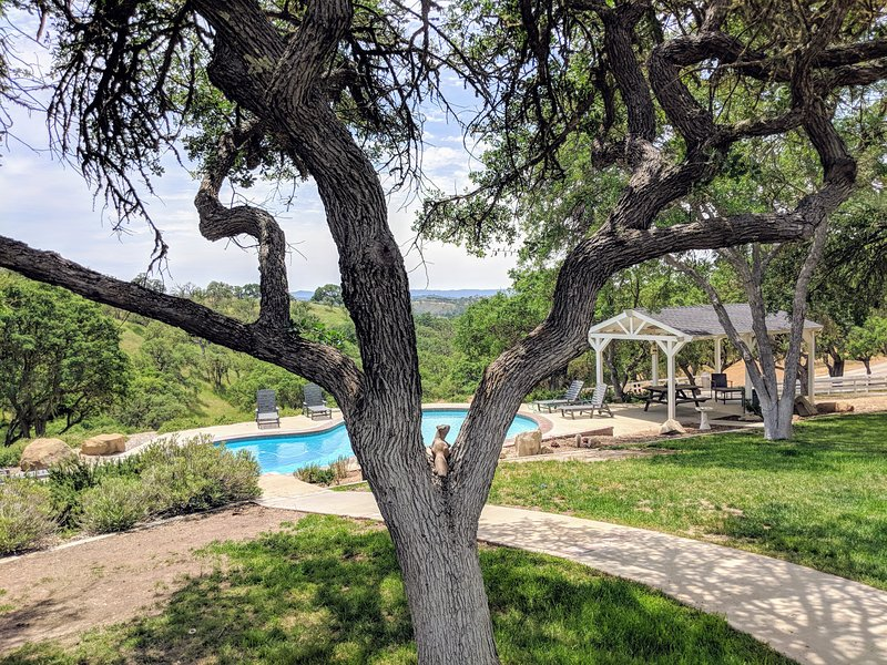30 acre ranch with pool, tennis court, sunset pergolas, hiking trails, and vineyard vista views