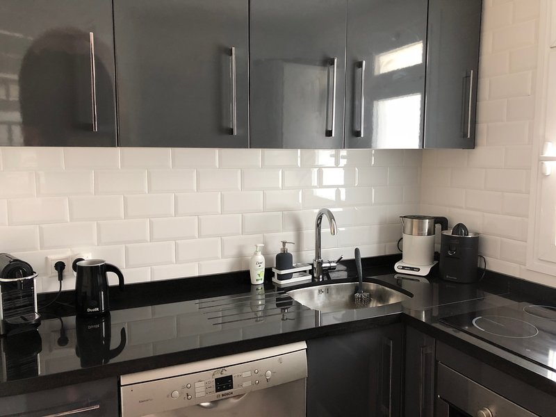 Modern kitchen fully equipped, large fridge, dishwasher, cooker, microwave etc.