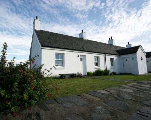 An Rhuba Cottage by Oban on Realxing Easdale Island with sea views, sleeps 6, holiday rental in Balvicar