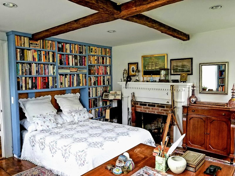 Bedroom in a Library. 3000 books, desk, fireplace, dressing room and private doorway out to grounds.