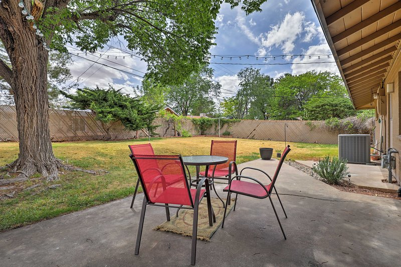 The 3-bedroom, 2-bath home boasts a private backyard with a tree-shaded patio.