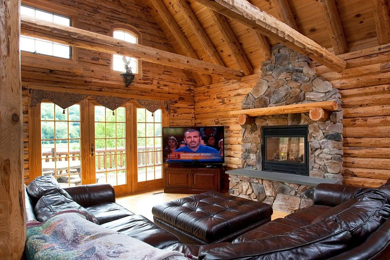 After a long day in the mountains, relax in front of the grand stone fireplace to warm up.
