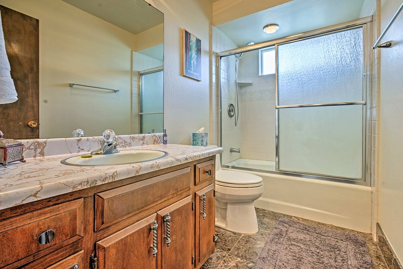 A shower/tub combo highlights this first bathroom.