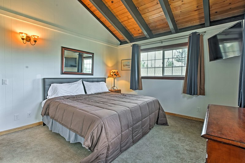This master bedroom offers a king-sized bed.