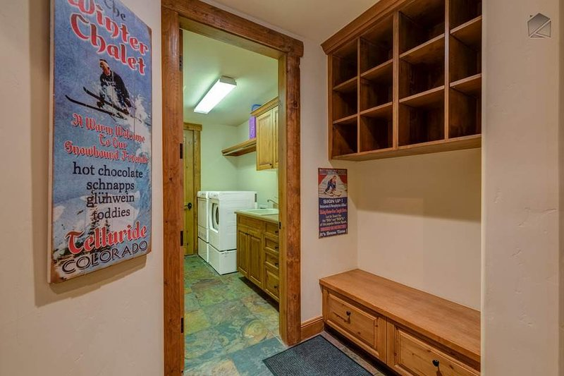 Just past the ski storage area you'll find the laundry room with a washer, dryer, and sink.