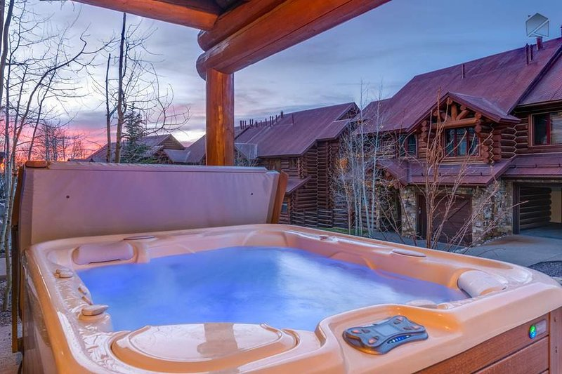 Soak in the large private hot tub on your outdoor deck.