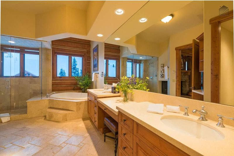 Two vanities and a separate steam shower and tub make it a treat to get ready in the Master Bathroom.