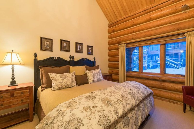 The second guest bedroom also has a split king bed, set under a cozy sloped ceiling.