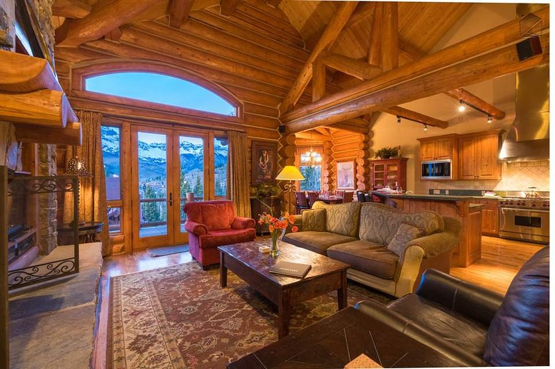 The classic log cabin design includes huge exposed wood beams overhead.