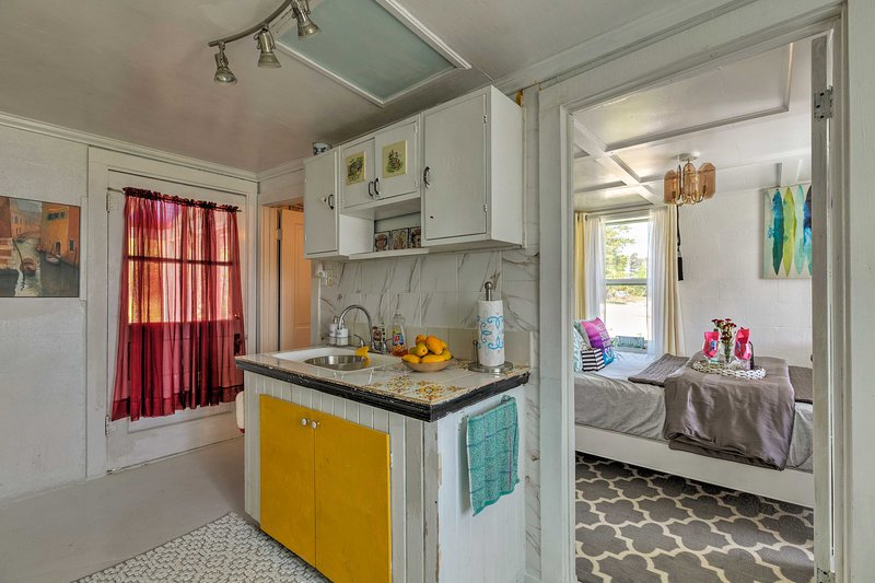 The first bedroom is adjacent to the kitchen.