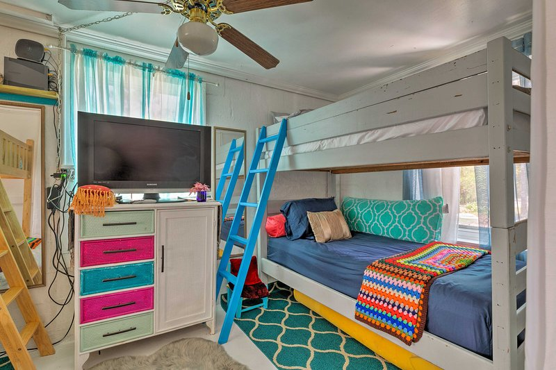 The second room has a set of twin-over-twin bunk beds.