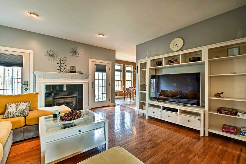 Curl up beside the electric fireplace to watch a movie on the flat-screen TV.