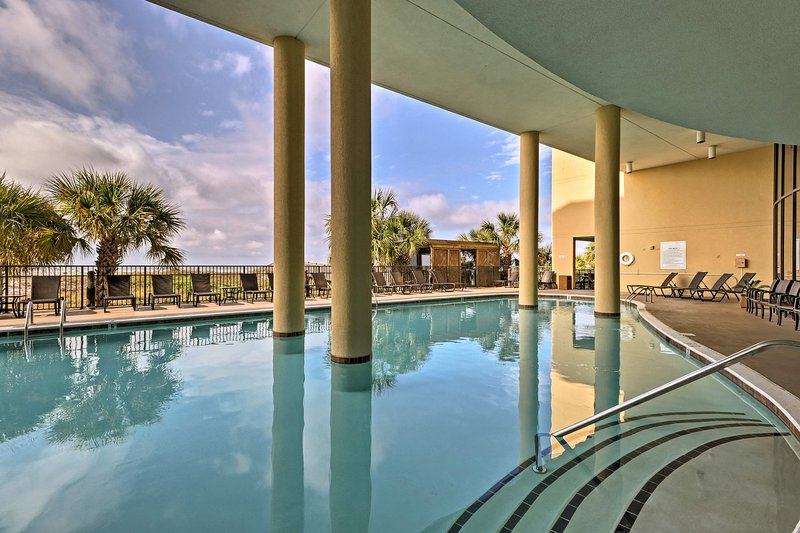 Spend sunny days lounging poolside at this Dauphin Island vacation rental condo.