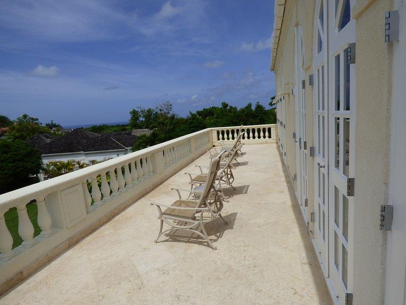 Upper balcony overlooking pool and gardens