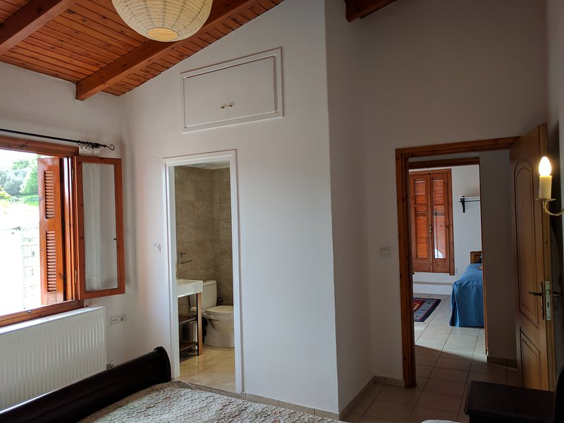 The suite: bedroom 1 looking into the bathroom, bedroom 2 and the door to the roof terrace.