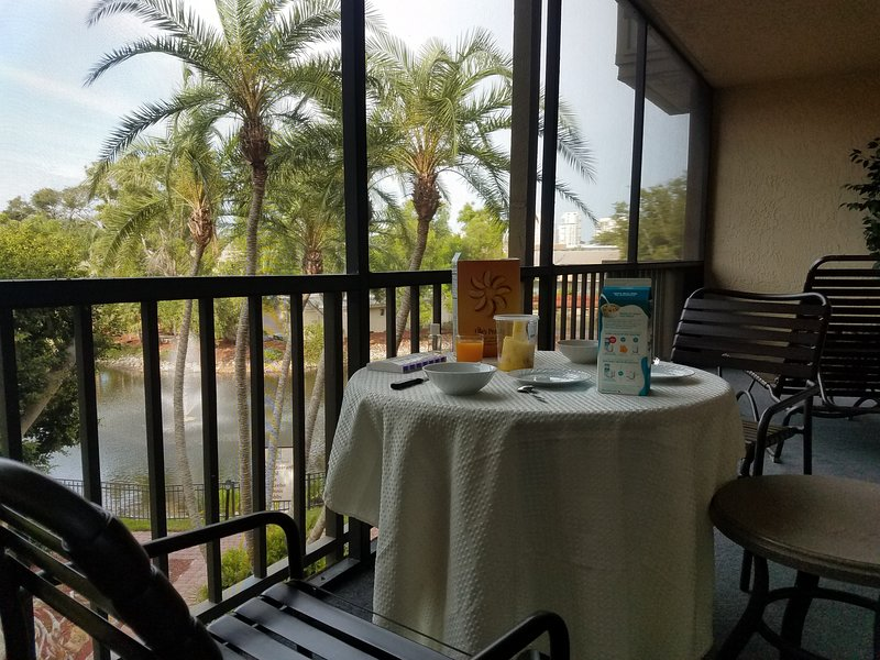 Start your day with breakfast in the lanai in front of the palm trees and pond.