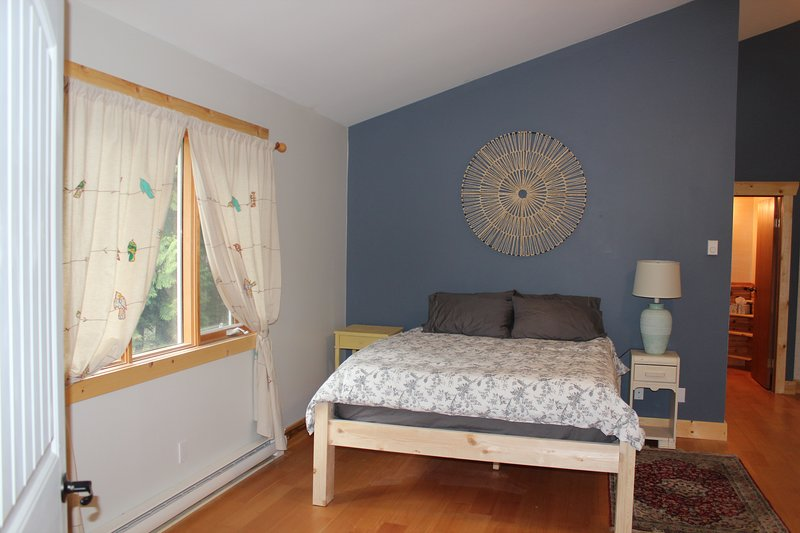 Comfortable queenbed in a spacious private upstairs suite.