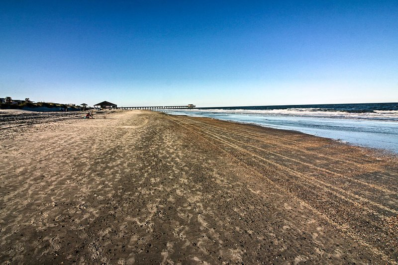 The ivory-sand shoreline of Tybee Beach is just steps away.
