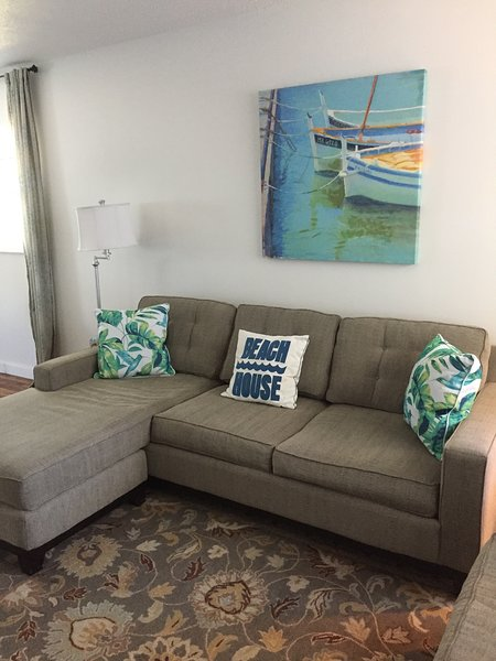 Comfy living room with queen sleeper sofa and loveseat.