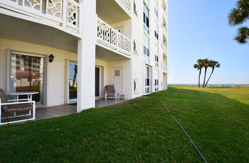 Ground Level Patio near the Beach & Pool, walking distance to the beach just beyond the trees -  El Matador Resort, Okaloosa Island Fort Walton Beach Vacation Rentals