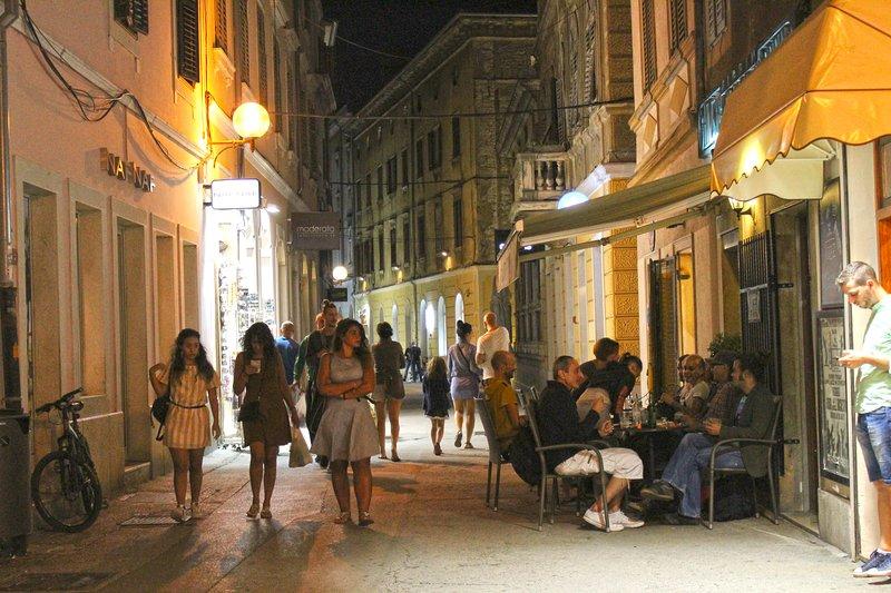 Main promenade street 'Ulica Sergijevaca' in the evening - Pula