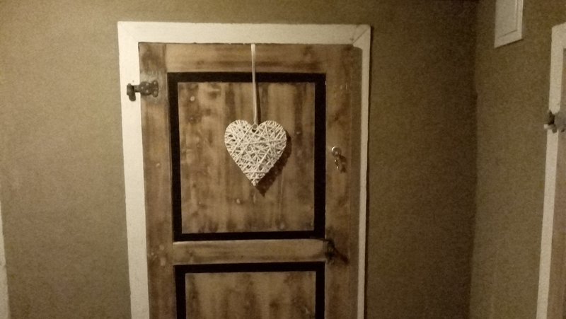 The entrance to the apartment with the newly sanded door.
