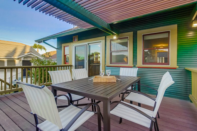 The deck has a table and chairs to enjoy your grilling adventure!