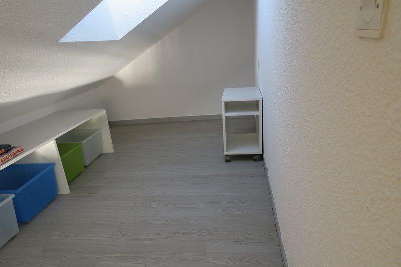 arrecadação / sala de jogos no andar de cima