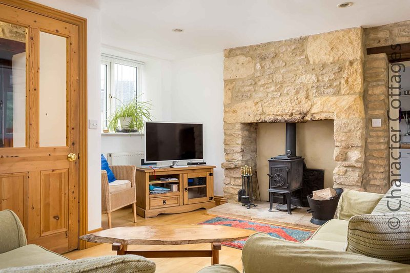 The light and spacious living room, with a Jotul log burner