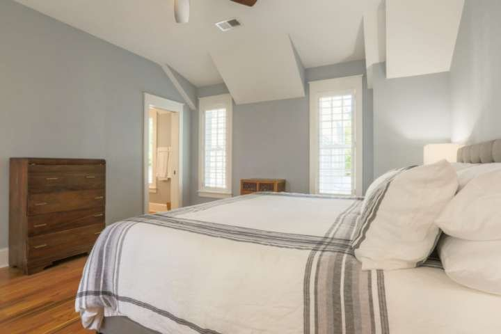The upstairs master bedroom also has a ceiling fan, dresser and an en suite bathroom.