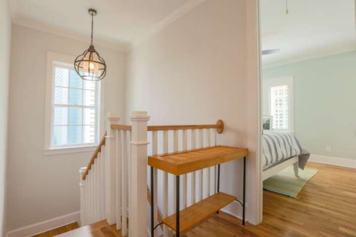 At the top of the stairwell, you'll find a central hallway that connects to all three of the upstairs bedrooms.