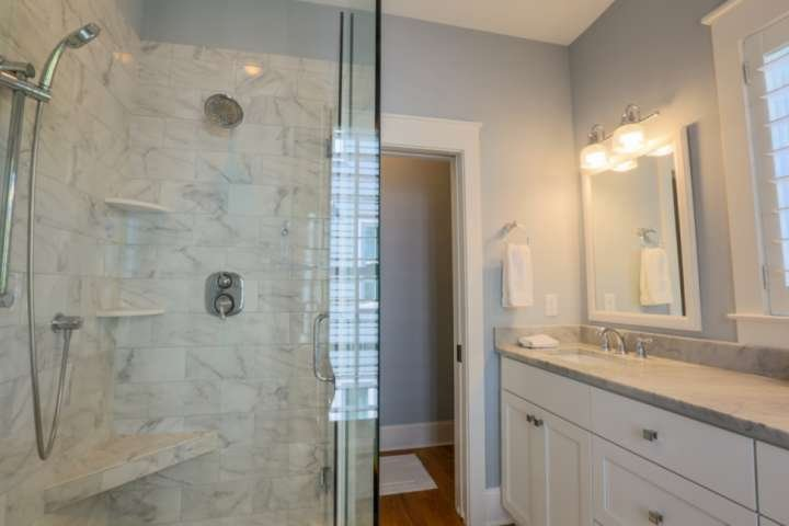 The second floor en suite bathroom also has a walk-in tiled shower, double sink vanity and separate water closet.