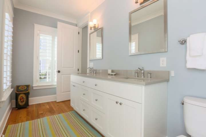 The jack & jill bathroom has a double sink vanity and a combined tub & shower.