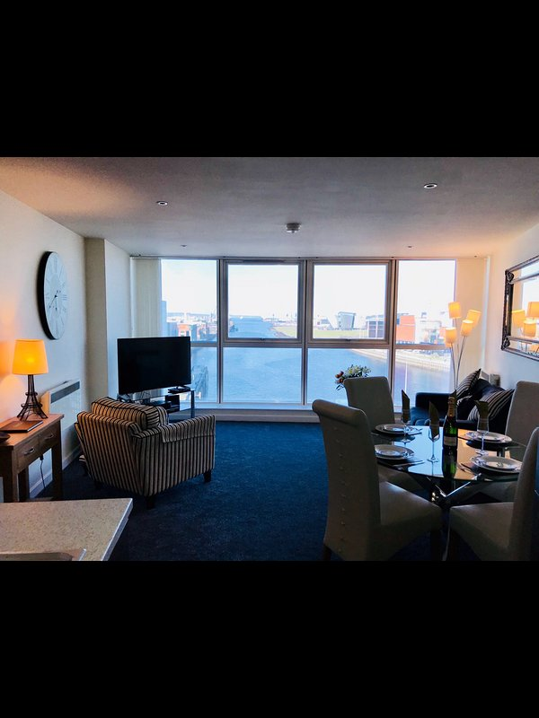 Lounge dining area with views of Titanic Quarter and Belfast Lough.