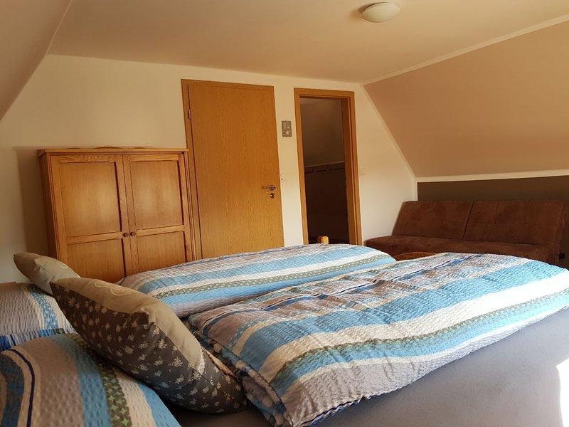 Top floor bedroom - with door to small, walk-in closet