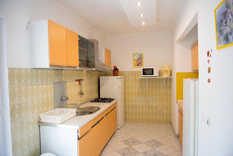 R1 (2): cucina in comune